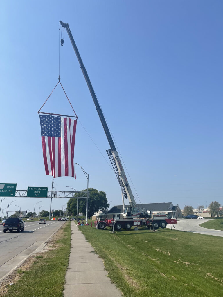 An American flag hangs over the roadway.